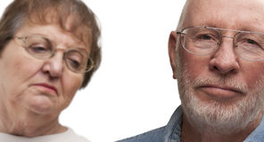 Meloncholy Senior Couple on White Royalty Free Stock Photo