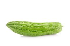 Melone amaro isolato su fondo bianco Immagini Stock
