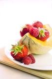 Melone con frutta rossa Immagine Stock