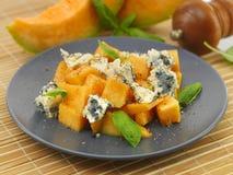Melone di melata con basilico e formaggio Fotografia Stock