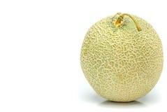 Melone di melata dal Giappone su un fondo bianco Immagini Stock Libere da Diritti