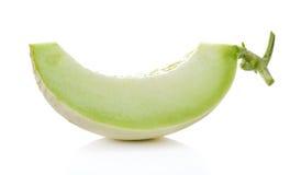 Melone di melata fresco su fondo bianco Fotografia Stock