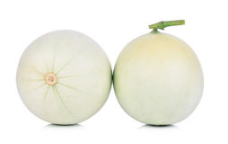 Melone di melata su priorità bassa bianca Immagini Stock
