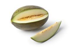 Melone di Piel de sapo e una fetta Fotografia Stock