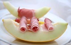 Melone e pancetta affumicata di melata Immagini Stock