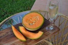 Melone und Champagner Stockfoto