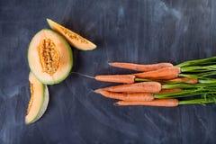 Melone und Karotten Lizenzfreies Stockbild