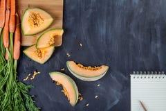 Melone und Karotten Stockfoto