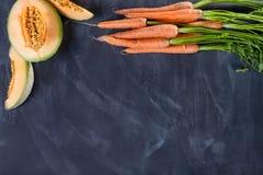Melone und Karotten auf die Oberseite Stockbild