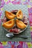 Melone und kurierter Schinken Stockfotos