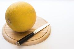 Melone und Messer Stockfotografie