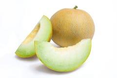 Meloneblatthonig und zwei Melonescheiben Lizenzfreie Stockbilder