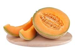 Melonen på träsnida stiger ombord Arkivfoton