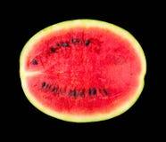 Melonenmuster lokalisiert auf einem schwarzen Hintergrund, die Ansicht von der Spitze Stockbild