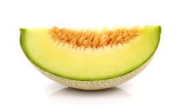 Melonenschnittstücke auf weißem Hintergrund Lizenzfreie Stockfotografie