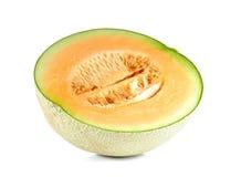 Melonenschnittstücke auf weißem Hintergrund Stockbilder