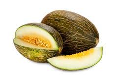 Melones de Piel de Sapo enteros y cortados Imagen de archivo