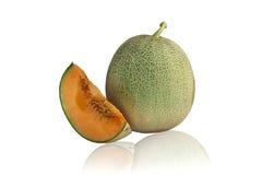 Melonjapan inom apelsinen royaltyfri foto