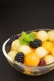 Melonowe piłki z jagodami Zdjęcia Stock