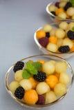 Melonowe piłki z jagodami Fotografia Royalty Free