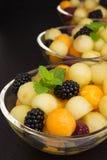 Melonowe piłki z jagodami Obraz Royalty Free