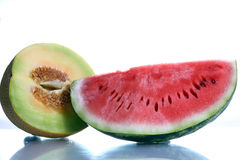 Melons. With reflection, food and nutrition at summer Stock Image