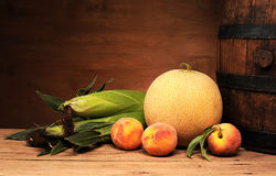 Melons, peaches and wooden barrel Stock Photography