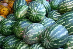 Melons. Watermelons at a market stall in South East Asia Stock Photos