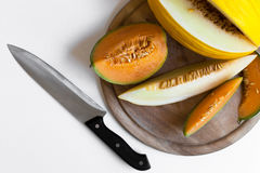 Melons  on a wooden board Royalty Free Stock Photo