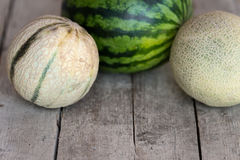 Melons on a wooden table Stock Photos