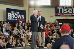 Senators McCain and Brown on Stage. Melrose, Massachusetts, USA - October 2012 - Senators John McCain and Scott Brown speaking to audience from stage during a Stock Photos