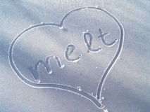 Melt. Heart and letters painted on a frosted table Royalty Free Stock Photography