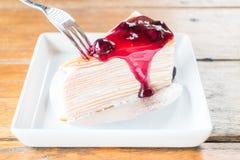 Melt blueberry sauce whipped cream crepe cake Royalty Free Stock Photo