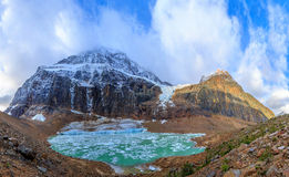 Melt-water lake below Mount Edith Cavell. Jasper National Park, Alberta, Canada stock photography