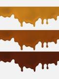 套Melted在白色背景的巧克力水滴 免版税库存照片