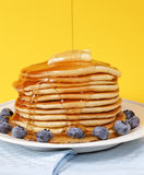 Melted butter with maple syrup on Stock Image
