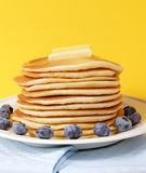 Melted butter on pancake Stock Images