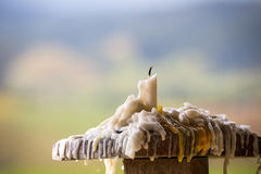 Melted candle on wood pole Royalty Free Stock Photography
