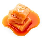 Melted caramel candies with sea salt stock images