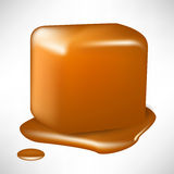 Melted caramel cube. Single melted caramel piece in cube shape Stock Images