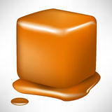 Melted caramel cube. Single melted caramel cube in perspective view Royalty Free Stock Photo