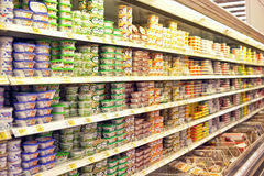 Melted cheese on supermarket shelves. St. Petersburg, Russia Stock Photography