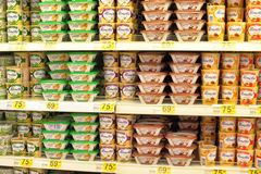 Melted cheese on supermarket shelves Royalty Free Stock Photography