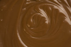 Melted Chocolate. Liquid Melted rich dark Chocolate detail. Close-up stock photography