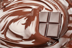 Melted chocolate. Bar in swirl Royalty Free Stock Photography