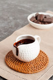 Melted chocolate in ceramic sauceboat Stock Photo
