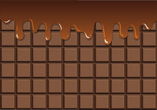 Melted chocolate on chocolate bar Royalty Free Stock Images