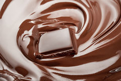 Melted chocolate. Dark melted chocolate bar in swirl Stock Image