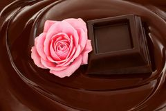 Melted chocolate dripping with chocolate bar and rose Stock Photography