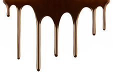 Melted chocolate dripping on white Stock Images